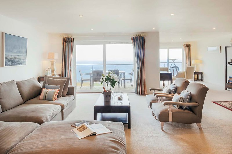 Open plan living & dining area with sliding doors to your own balcony with amazing sea views