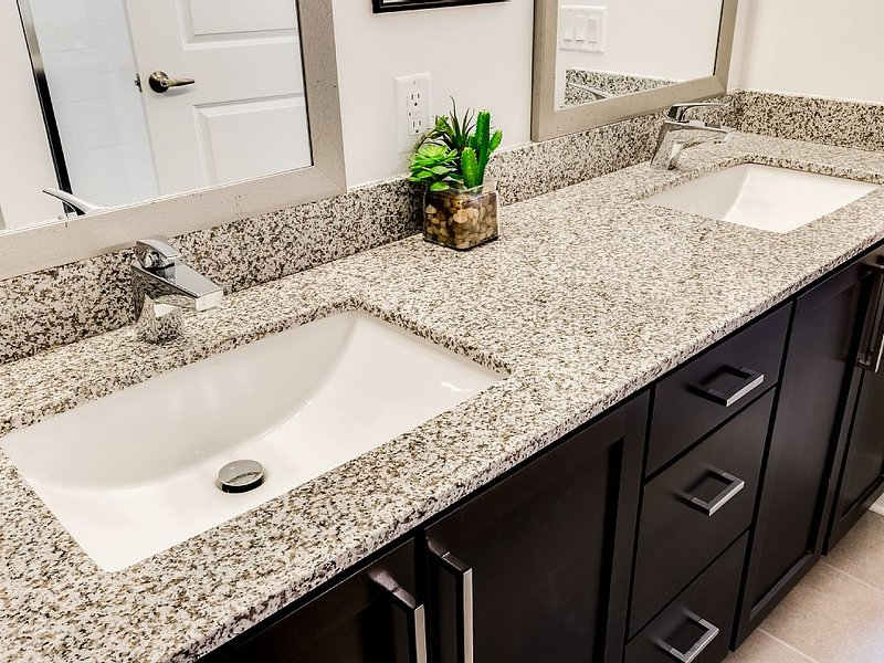 Our master bath features  his-and-hers vanity mirrors and sinks.