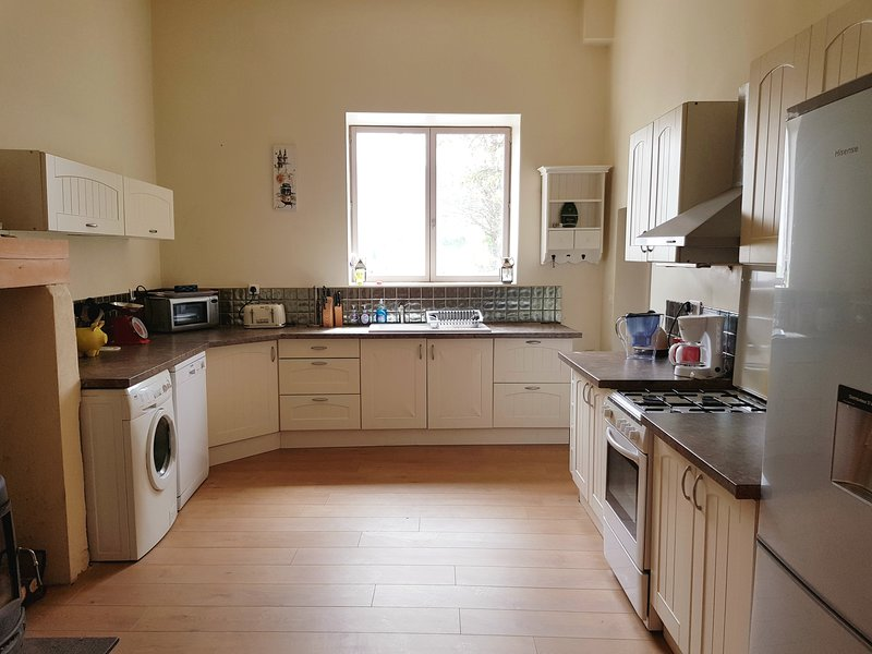 Large sunny kitchen with all mod cons