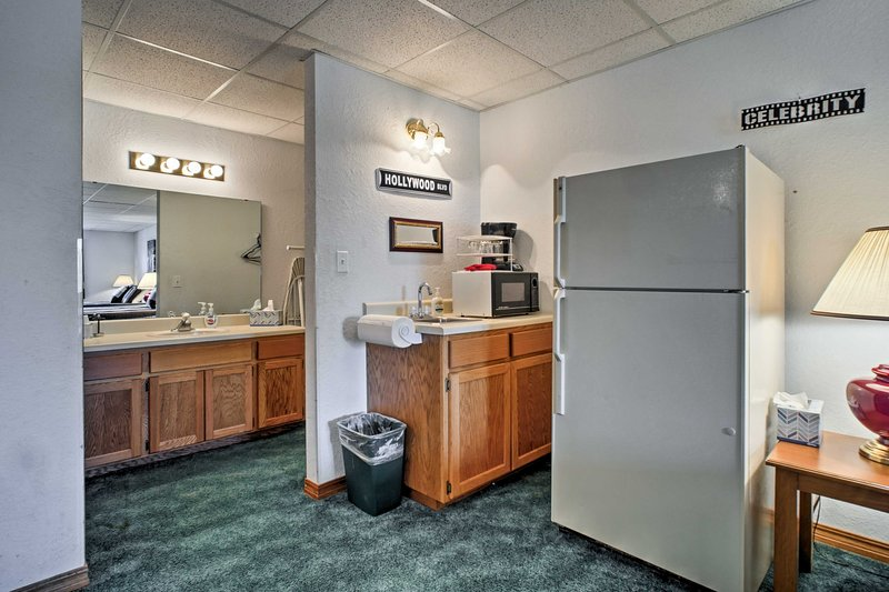 The room also features a small kitchenette.