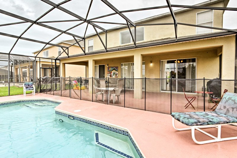 Take a dip in the heated pool during your next trip to Kissimmee!