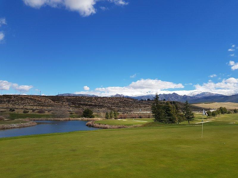 View of snow capped Sierra Nevada mountains from Santa Clara Golf Course near Granada