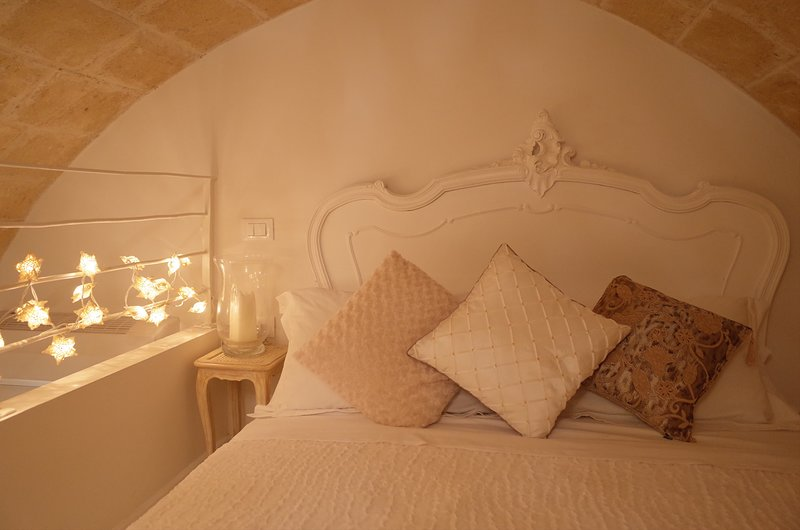 Relax in the extra large king size beds with refurbished antique bedheads