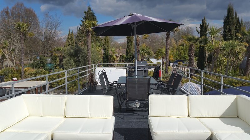 Outside dining & seating areas on the roof garden including a gas BBQ
