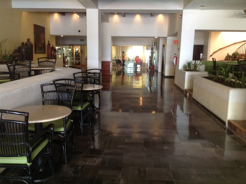 part of the lobby with many restaurants, info about the all inclusive from the Hotel in my condo