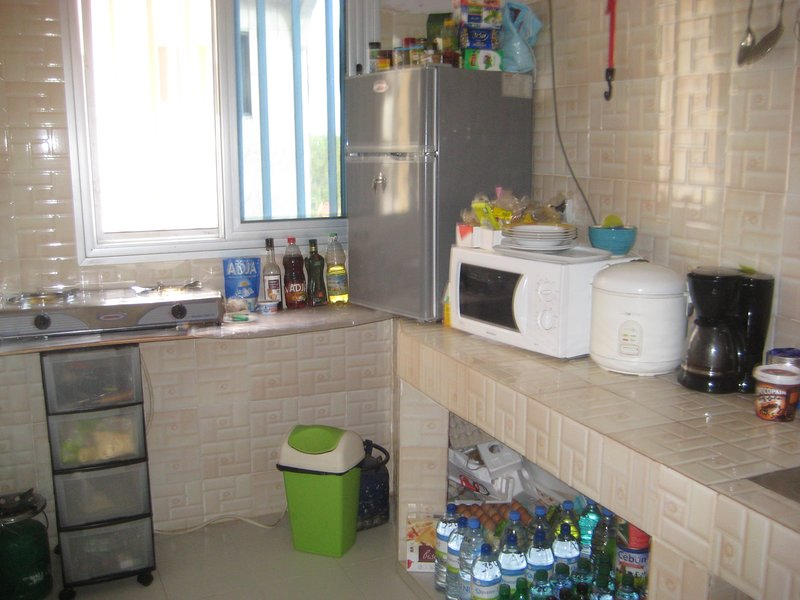 shared kitchen preparing French meals; Senegalese selling DRINKS