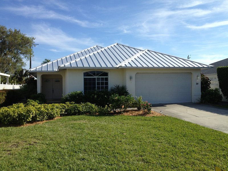 Front of home with new hurricane proof steel roof.