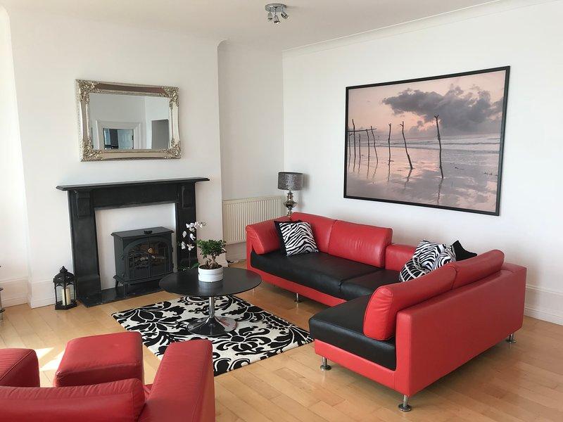 Spacious contemporary lounge with sea views.