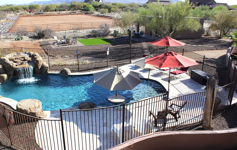 View of Casita from view deck, with outdoor patio, fire pit and saltwater pool.