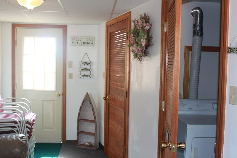 Breezeway with Foosball  Table and access to Patio and Laundry Room