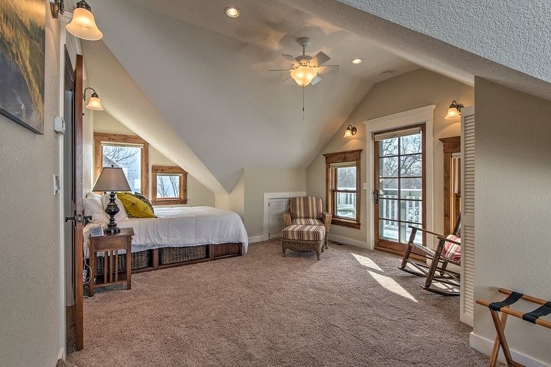 This well-appointed bedroom features a private balcony.