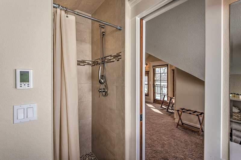 This walk-in shower comes complete with a detachable shower head.