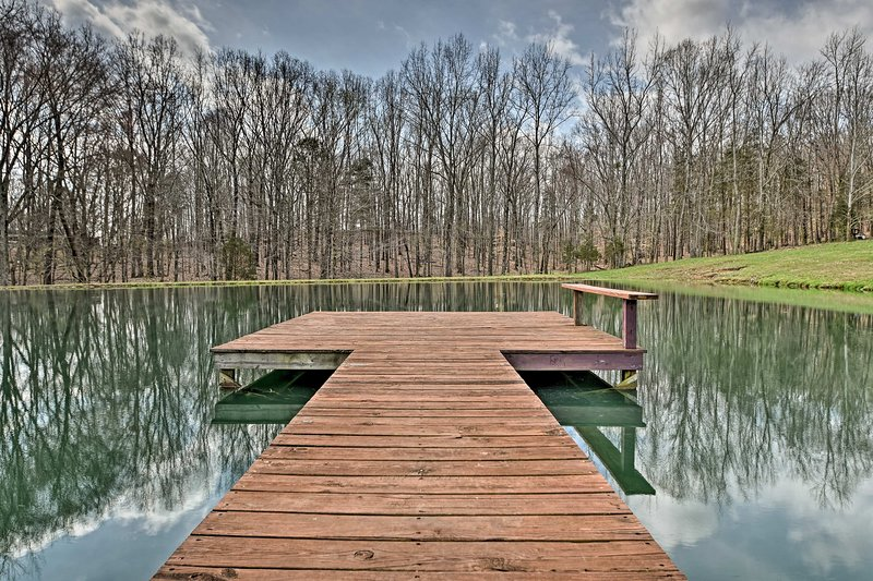 The cabin is situated on a 50-acre lot with ponds, creeks, a fire pit and more.