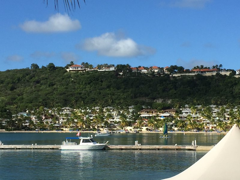 view from the beach bar overlooking the village of villas and mamora bay