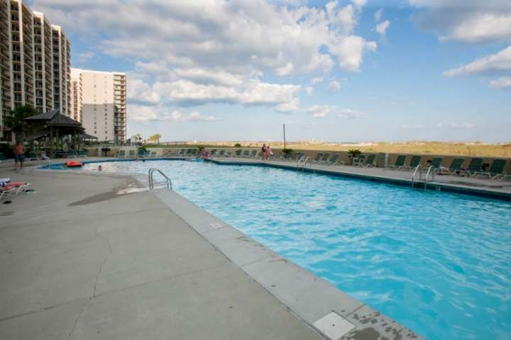 Community pool and lounge chairs