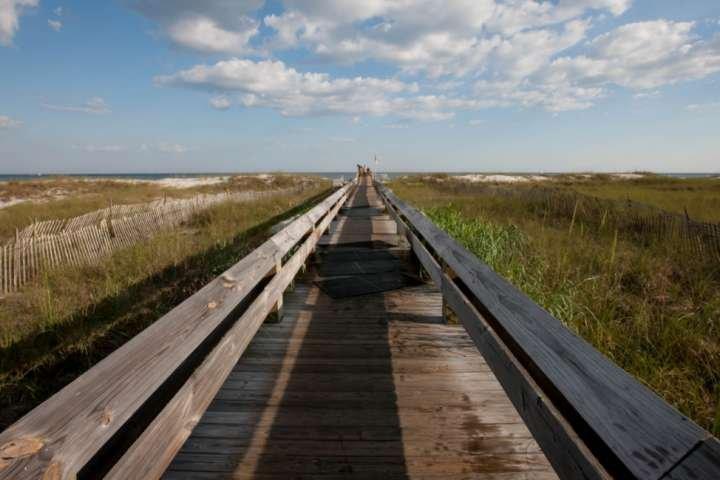 Community boardwalk leading to beach and Gulf
