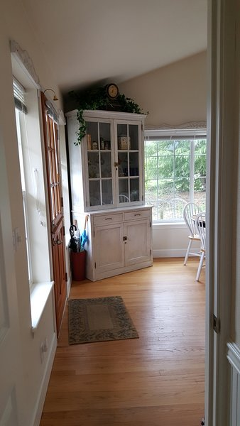 Dutch front door, looking from bathroom. Hutch holds pantry items, extra dishes, pots, pans