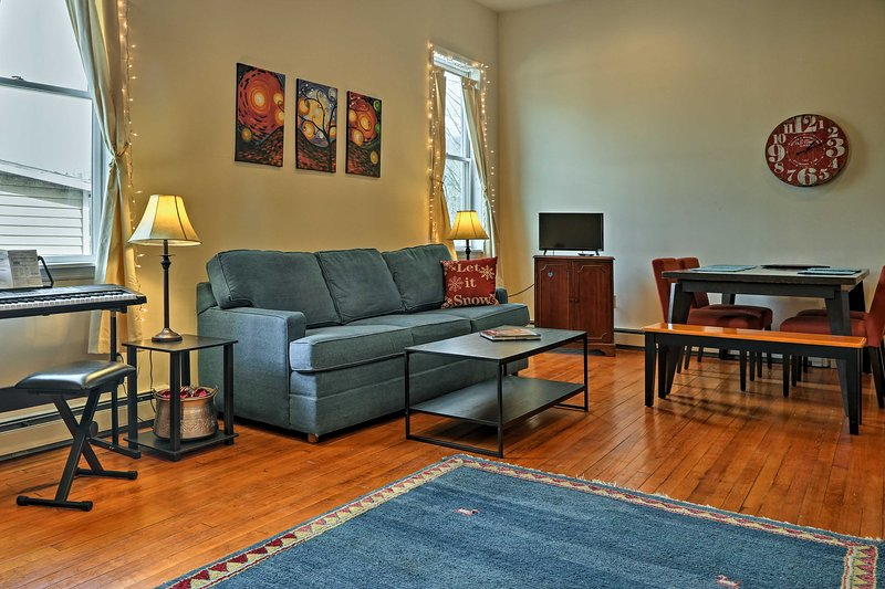Relax on the plush sofa while you watch the flat-screen cable TV.