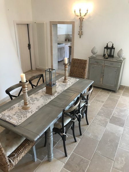 Dining table situated in the new extension room with patio doors to the magnificent patio terraces.