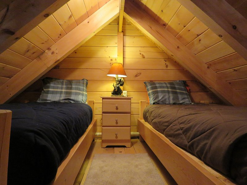 Loft area with two twin beds.