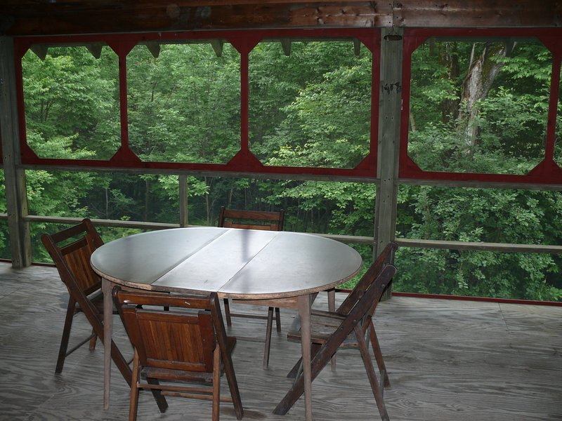 Enjoy your meals or play cards on the large porch.