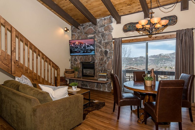 Main level living area with large flatscreen TV and gas fireplace