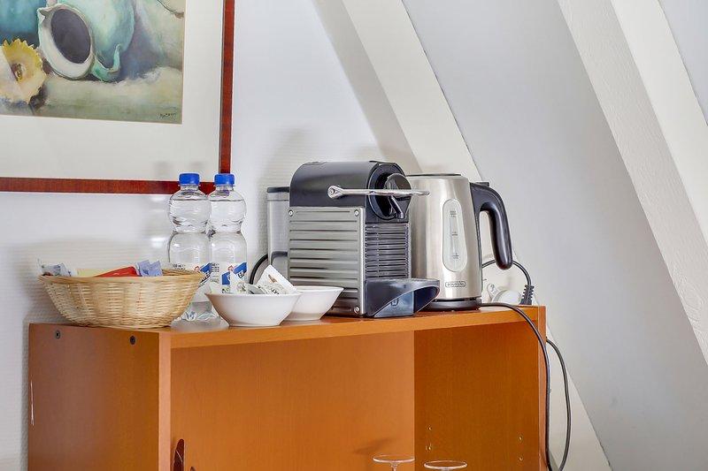 Nespresso coffee maker and watercooker