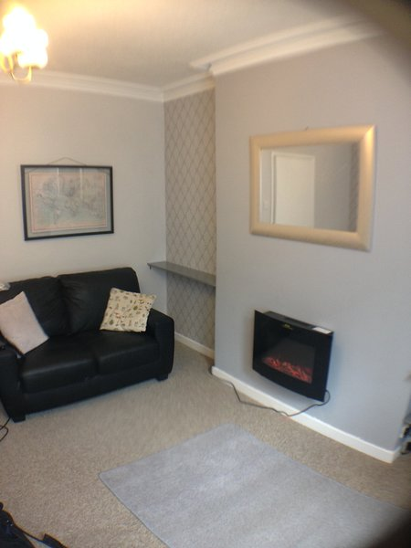 Living room with TV, DVD player and freeview TV channels.