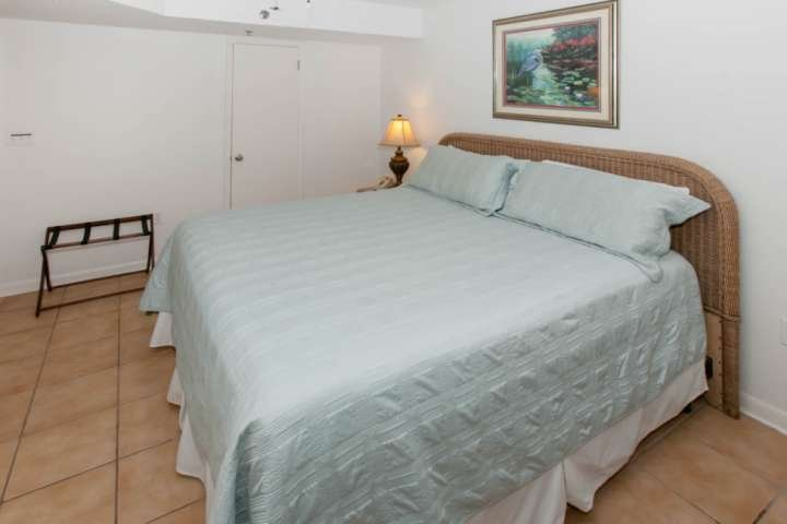 Bedroom with tiled floor and king size bed