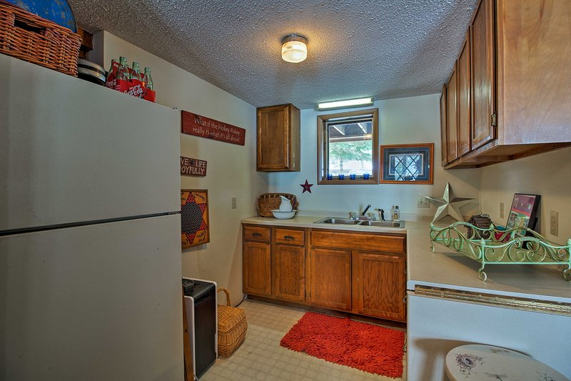 Find a sink and fridge in the downstairs kitchen area.
