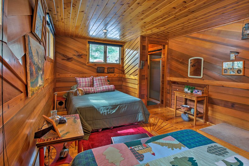 Wood paneled walls exude a cozy cabin feel.