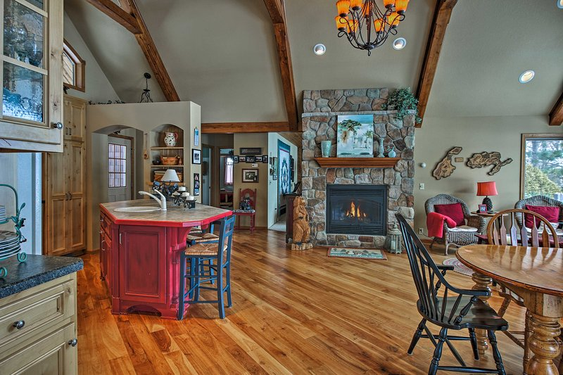 A gorgeous stone fireplace highlights the main room!