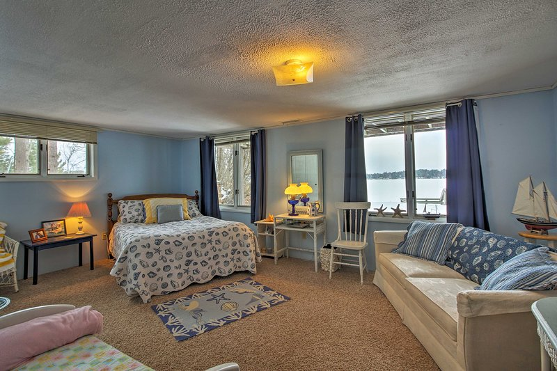 This spacious room features a queen bed and sleeper sofa.
