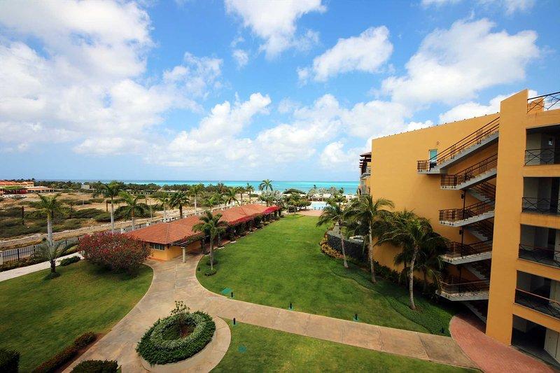 BEACHFRONT - EAGLE BEACH - OCEANIA RESORT - Emerald  View 2BR condo - P416, vacation rental in Aruba