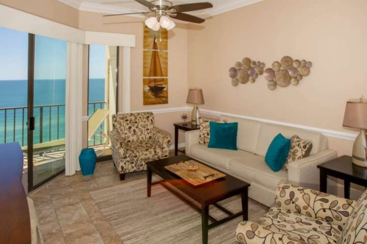 Living room with seating for 4 and private Gulf-front balcony access