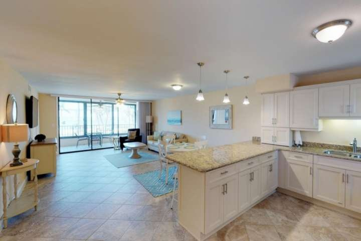 The newly renovated condo is beautifully decorated in soft, muted tunes with accents of blue, reflecting the water seen just outside the lanai.