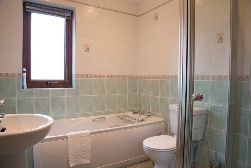 Bathroom with separate shower cubicle and power shower