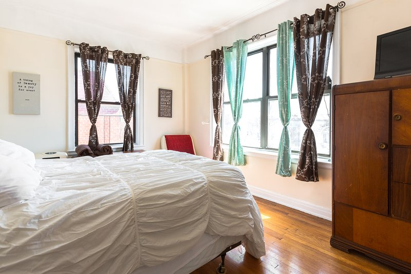 This nice bedroom has a nice sitting area so you can get comfortable with a good book & enjoy a book