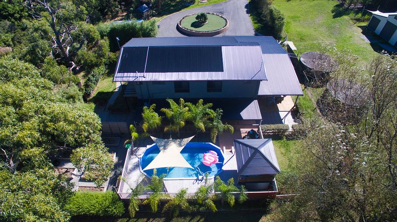 Aerial view of house and pool area.