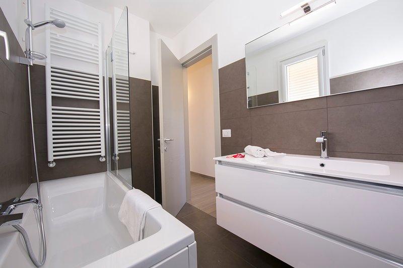 Bathroom 3 with a bath tub with shower