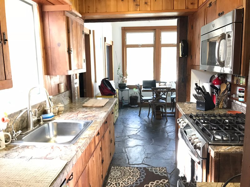 Kitchen, fully supplied with appliances, dishes, pots, etc.