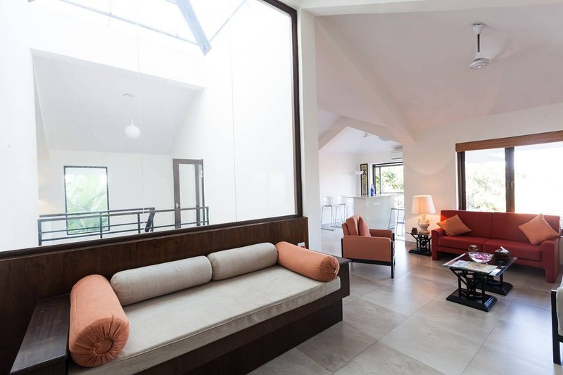 The open plan living and dining area on the first floor lit by large windows
