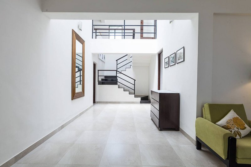 Ground floor open plan living space with staircase leading up to the first-floor living space