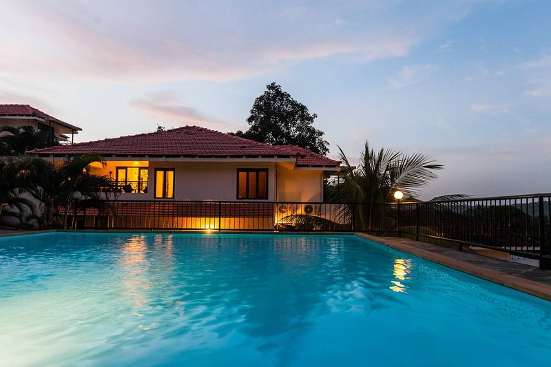 Sunset by the poolside with at this Holiday Home in North Goa