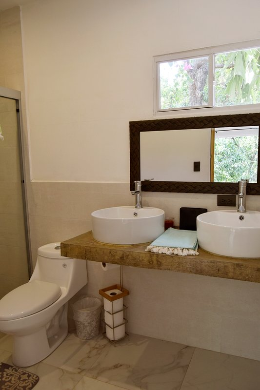 The new Master Bath provides upgraded amenities like his/her sinks and marble stone tiles