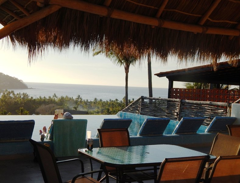 Enjoy meals and relaxation under the Palapa's shade