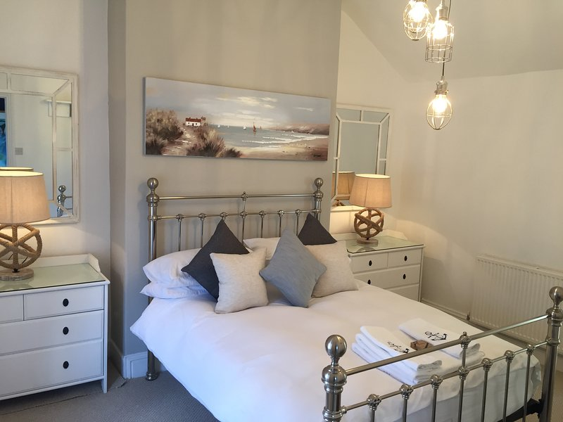 Master bedroom with double bed, spacious luxurious en suite bathroom and views of Warkworth Castle.
