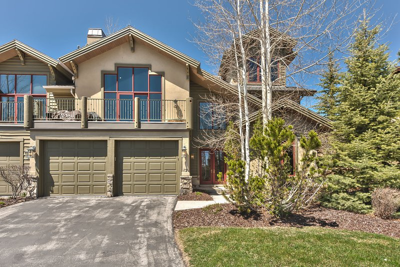 Front exterior with a large deck, garage and amazing views of Park City
