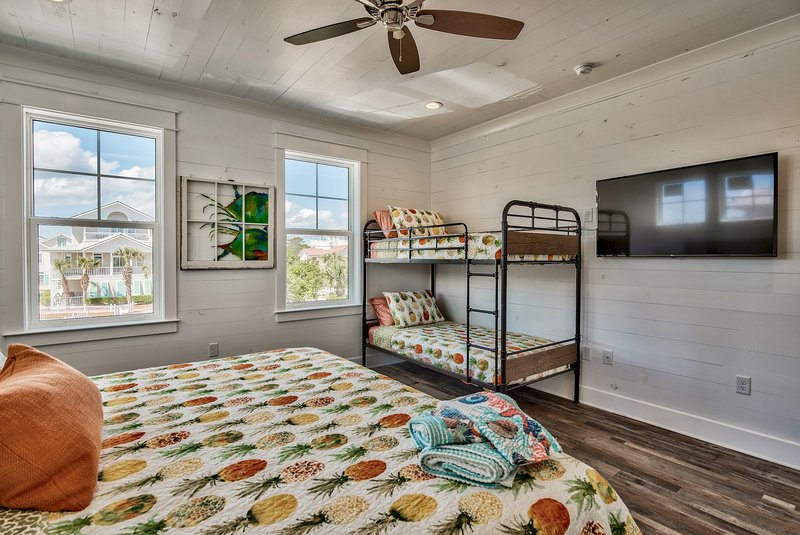 King bedroom #6, also set of twin bunks, private bathroom, tub/shower combo, wall-mounted TV