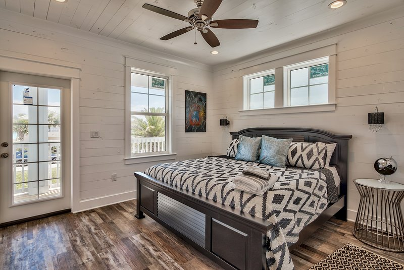King bedroom #4, opens to balcony with views to beach, private bathroom, wall-mounted TV